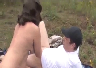 Big-boobed mother bangs outdoors with her son