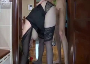 Busty mother in stockings gives a deepthroat