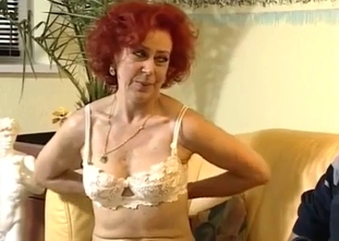 Stunning redhead MILF gives her son a blowjob