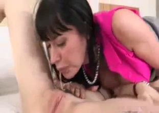 Mommy and stepdaughter are sucking a big boner