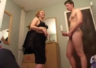 Redhead MILF blows her son's dick with passion