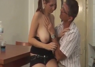 Nerdy dad undresses his big-breasted daughter