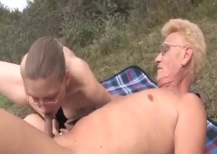 Old sister gives her brother a blowjob